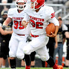 John P. Cleary |  The Herald Bulletin<br /> Frankton's Will Harris scampers down field for a 45-yard TD.