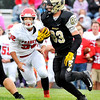 John P. Cleary    The Herald Bulletin<br />  Madison-Grant's Alex Webb looks up field as Frankton's Will Harris closes in.