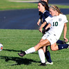 John P. Cleary | The Herald Bulletin <br /> Pendleton Heights Taylor Fort lets the ball go on a break against Delta's Sabreena Ferguson to score the Arabians third goal of the first half.