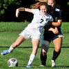 John P. Cleary | The Herald Bulletin <br /> Pendleton Heights Shayla Meinders gets her arm caught up with Delta's Jaycee Whitesell as they fight for the control of the ball.