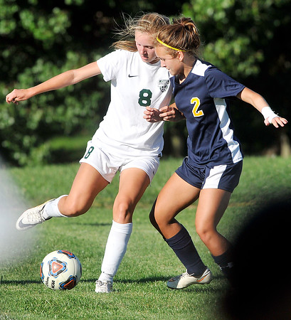 John P. Cleary | The Herald Bulletin <br /> Pendleton Heights Anna Childers works to get the ball out of the corner against Delta's defender Jenna Whitesell.
