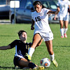 John P. Cleary | The Herald Bulletin  <br /> Delta's Kyndall Pursley slides in to try to kick the ball away from Pendleton's Deisdy Ridriguez.