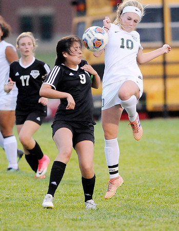 Don Knight   The Herald Bulletin<br /> Pendleton Height's Taylor Fort and Yorktown's Jaylynn Chavez fight for control of the ball on Tuesday.