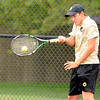 Don Knight | The Herald Bulletin<br /> Madison-Grant's Hayden Retherford returns a volley as he and Dillon Sneed faced Alexandria's Derek Stinefield and Seth Parker at No. 1 doubles as the Tigers hosted the Argylls on Wednesday.