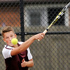 Don Knight | The Herald Bulletin<br /> Alexandria's Trevor Simison follows through as he returns a volley to Madison-Grant's Tucker Robertson in the No. 3 singles match as the Tigers hosted the Argylls on Wednesday.