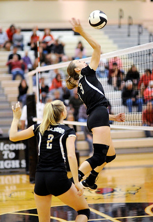Don Knight | The Herald Bulletin<br /> Lapel's Taylor Murdock attacks the ball  as the Bulldogs hosted the Anderson Indians on Wednesday.