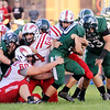 Don Knight | The Herald Bulletin<br /> Pendleton Heights running back Kamden Earley carries the ball and a host of New Palestine tacklers on Friday.