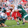 Don Knight | The Herald Bulletin<br /> Pendleton Heights' Cole Robison tackles New Palestine's Charlie Spegal on Friday.