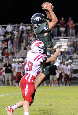 Don Knight | The Herald Bulletin<br /> Pendleton Heights' Anakin Allison makes a catch as he is covered by New Palestine's Luke Canfield  on Friday.