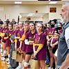 Assistant Alexandria-Monroe varsity volleyball coach Jeff Harmon addresses the crowd during ceremonies honoring the late Deanna Miller before the varsity match Wednesday. Miller was the long-time fixture within the community and the Tiger volleyball program.