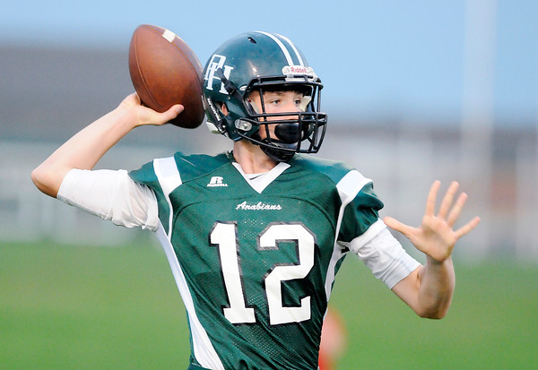 Don Knight | The Herald Bulletin<br /> Pendleton Heights' Christian Conkling passes the ball as the Arabians hosted New Palestine on Friday.