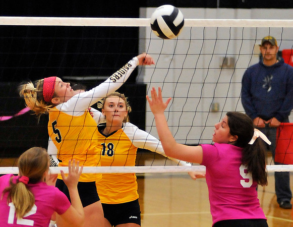 John P. Cleary |  The Herald Bulletin<br /> Shenandoah's Kamryn Buck taps the ball over the net between Daleville's Abbie Lee and Lindsay Ingenito.