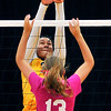 John P. Cleary |  The Herald Bulletin<br /> Shenandoah's Erikka Hill taps the ball over Daleville's Heather Pautler at the net.