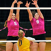 John P. Cleary |  The Herald Bulletin<br /> Daleville's Marlee Hobbs and Lindsay Ingenito leap to try and block the ball at the net.
