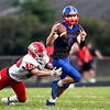 John P. Cleary | The Herald Bulletin<br /> Elwood's Chance Martin runs out of the pocket while being chased by Luke Sheward of Frankton.