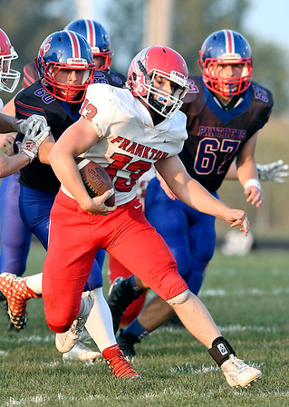 John P. Cleary | The Herald Bulletin<br /> Frankton's Korbin Finley makes a cut as Elwood defenders try to catch him as he breaks into open field.