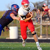 John P. Cleary | The Herald Bulletin<br /> An Elwood defender misses as Frankton's Jaxen McCorkle makes a cut up field.