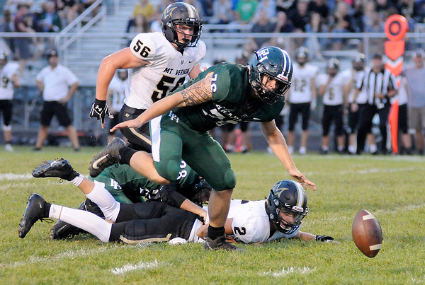 Don Knight | The Herald Bulletin<br /> Pendleton Heights' Tremor Bynum recovers the ball after Luke Bays knocked the ball loose from Mt. Vernon's Shaun Shipley on Friday.