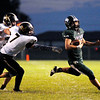 Don Knight | The Herald Bulletin<br /> Pendleton Heights' Kamden Earley evades a pair of Mt. Vernon tacklers on Friday.