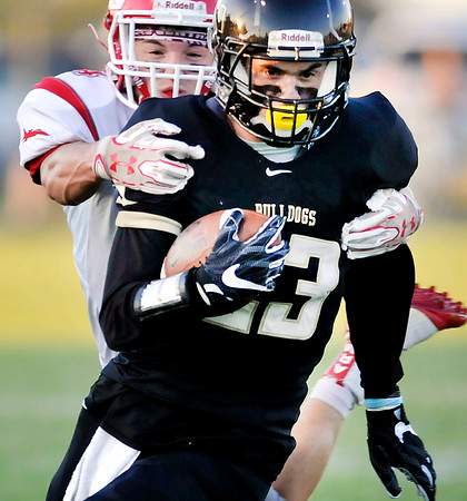 John P. Cleary   The Herald Bulletin<br /> Lapel's Drew Reed gets caught from behind by Adams Central defender Gabe Schwaller.