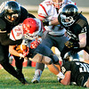 John P. Cleary | The Herald Bulletin<br /> Swarming defense by Lapel's Richard Ficociello, Blade Lambrou, and Josiah Hudson stops Adams Central runner Blake Bauman for no gain.