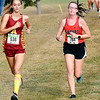 Alexandrias' Reanna Stinson and Caitlin Cole, of Frankton, keep pace with each other mid-race with Stinson pulling ahead and finishing seventh with Cole finishing eighth.