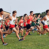 67 runners break for position at the start of the Madison County Boys Cross Country race Tuesday.