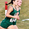 Pendleton Heights Laney Ricker and Katie Jones are stride-for-stride as they round the post at the one K marker during the Madison County Cross Country meet Tuesday. Jones won the race with Ricker finishing second.