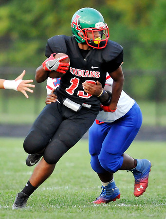 John P. Cleary | The Herald Bulletin<br /> Anderson's Jalen Swain makes a cut up field to gain yardage against Kokomo.