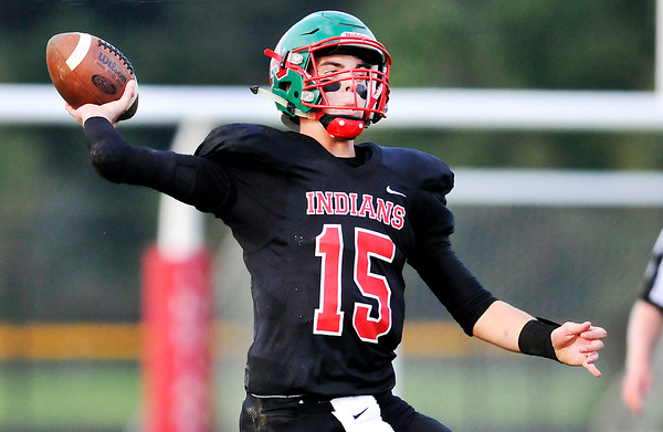 John P. Cleary | The Herald Bulletin<br /> Anderson QB Dylan Barron throws the football after scrambling to find an open receiver, then hitting Aaron Armstrong for a 33 yard touchdown strike.
