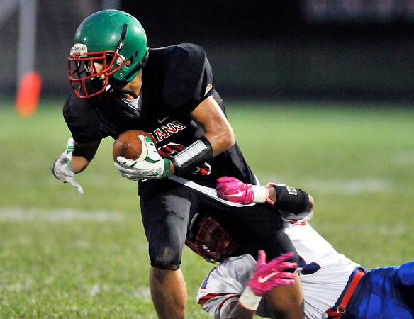 John P. Cleary | The Herald Bulletin<br /> Anderson wide receiver Jove'on Poor drags the defender as he keeps his feet for more yardage after catching a pass.