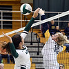 John P. Cleary | The Herald Bulletin<br /> Pendleton's Aubree Dwiggins tries to block the ball as Delta's Darian Barnard taps the ball over the net.