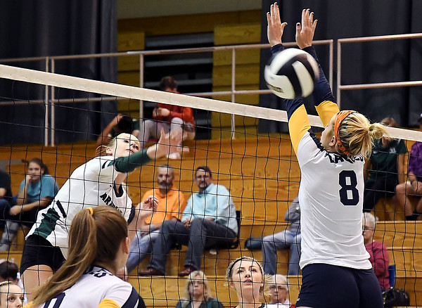 John P. Cleary | The Herald Bulletin<br /> Pendleton's Avery Ross makes a kill against Delta's Chloe Coleman.