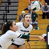 John P. Cleary | The Herald Bulletin<br /> Pendleton's Gracie Criswell plays the serve as Brynn Teague watches.