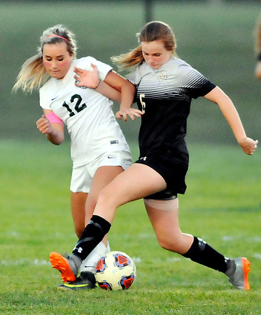 John P. Cleary |  The Herald Bulletin Pendleton Heights Lexi Hill and Mount Vernon's Datie Gawrys try to hold each other off the ball.