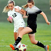 John P. Cleary |  The Herald Bulletin<br /> Pendleton Heights Lexi Hill and Mount Vernon's Datie Gawrys try to hold each other off the ball.