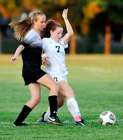 John P. Cleary    The Herald Bulletin<br /> Alaina Nelson, of Mount Vernon, and Pendleton Heights Sarah Dix fight for control of the ball.