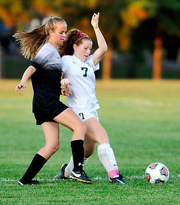 John P. Cleary |  The Herald Bulletin Alaina Nelson, of Mount Vernon, and Pendleton Heights Sarah Dix fight for control of the ball.