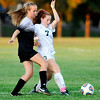 John P. Cleary |  The Herald Bulletin<br /> Alaina Nelson, of Mount Vernon, and Pendleton Heights Sarah Dix fight for control of the ball.