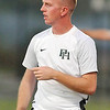 John P. Cleary |  The Herald Bulletin<br /> Pendleton Heights head coach Mark Davy watches the play of his girls during their soccer match with Mount Vernon.