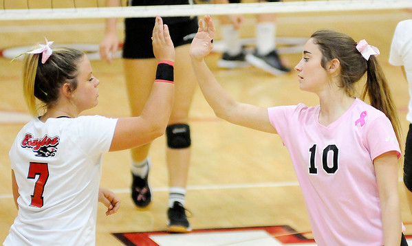 Don Knight | The Herald Bulletin<br /> From left, Frankton's Aleyah Rastetter and Rylee Barker high five after a point as the Eagles hosted the Madison-Grant Argylls on Tuesday. Read about the outcome of the game in today's Sports section.