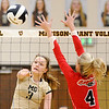 Don Knight | The Herald Bulletin<br /> Madison-Grant's Mia Stewart attacks the ball as Frankton's Audrey Cleek attempts to block her on Tuesday.