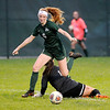 Don Knight | The Herald Bulletin<br /> Hamilton Heights goalie Alyssa Irwin comes out of the goal to challenge Pendleton Heights' Macy Browning who makes her pay the price scoring a goal to put the Arabians up 2-0 on Wednesday.