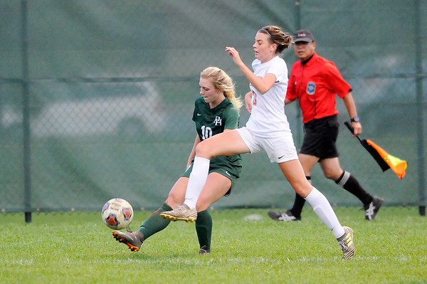Don Knight | The Herald Bulletin<br /> Pendleton Heights' Taylor Fort sends the ball across to teammate Claire Fendel who scores a goal as the Arabians hosted the Hamilton Heights Huskies on Wednesday.