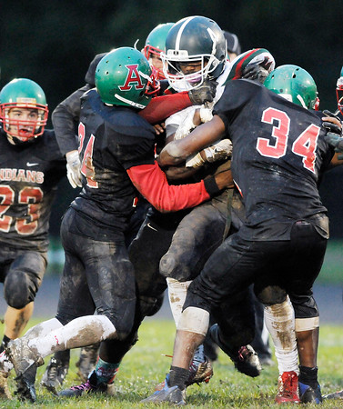 Don Knight   The Herald Bulletin<br /> Keyounis Woods, left, and Jaleel Patterson Sr. tackle Arsenal Tech's Gerald Garrett during homecoming on Friday.