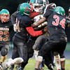 Don Knight | The Herald Bulletin<br /> Keyounis Woods, left, and Jaleel Patterson Sr. tackle Arsenal Tech's Gerald Garrett during homecoming on Friday.