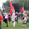 Don Knight | The Herald Bulletin<br /> Madison Heights and Highland mascots joined the Indian and Maiden to lead the Anderson Indians onto the field for their homecoming matchup against Arsenal Tech on Friday.