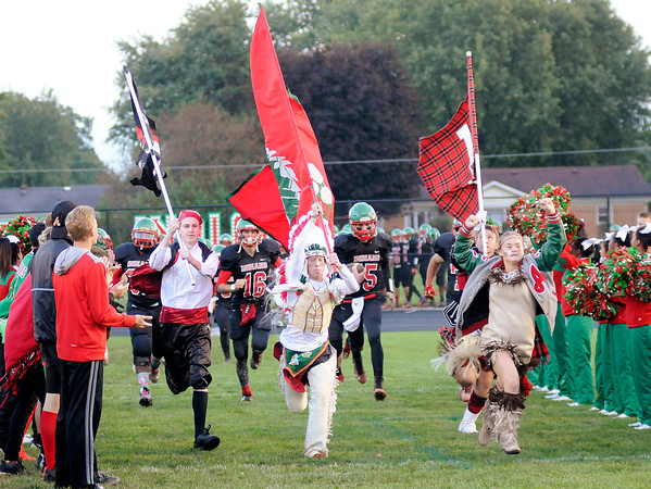 Don Knight | The Herald Bulletin Madison Heights and Highland mascots joined the Indian and Maiden to lead the Anderson Indians onto the field for their homecoming matchup against Arsenal Tech on Friday.