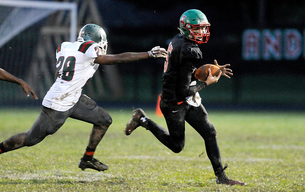 Don Knight | The Herald Bulletin<br /> Anderson's Dylan Barron scrambles as he is pursued by Arsenal Tech's Montez Warren during homecoming on Friday.