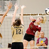 Don Knight | The Herald Bulletin<br /> Alexandria's Megan Miller scores a kill as she hits the ball around Madison-Grant blockers Sloane Stewart and Kayla Comer on Saturday.